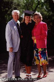 Grandparents w/ granddaughter on graduation